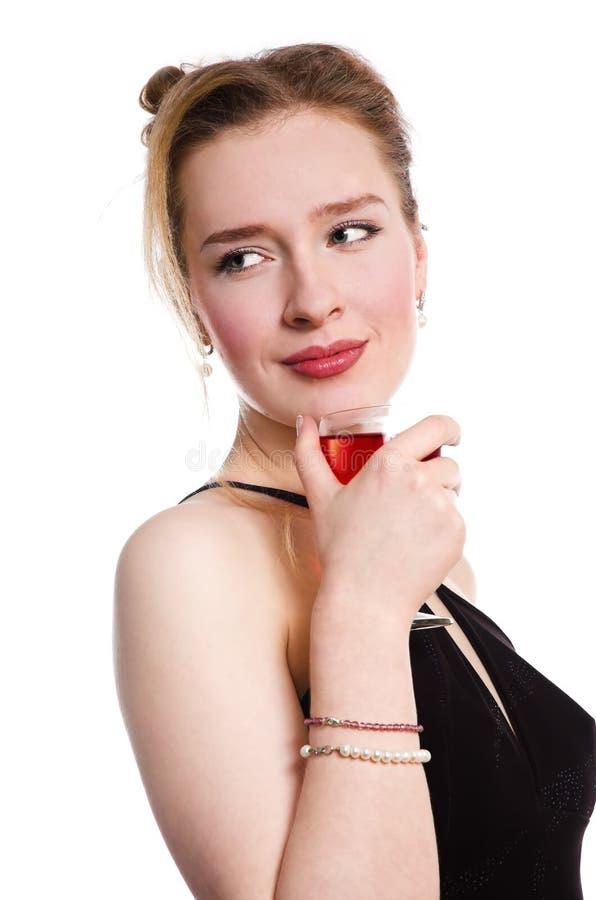 Vrouw met een glas wijn stock fotografie