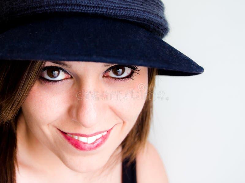 Vrouw met een hoed stock afbeelding