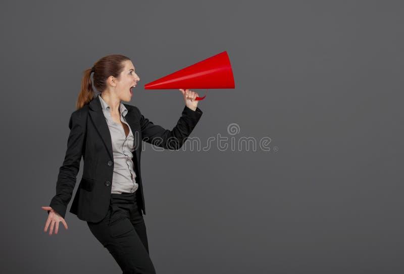 Vrouw met een megafoon royalty-vrije stock foto's