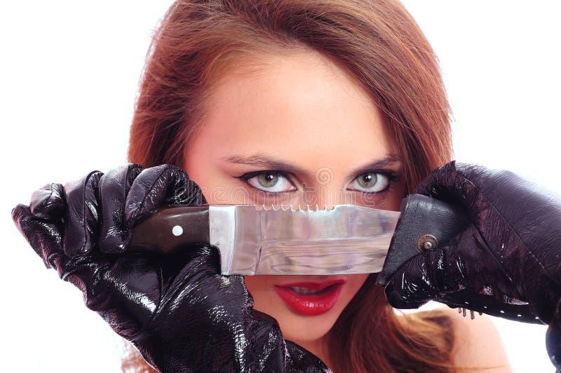 Vrouw met een mes stock foto's