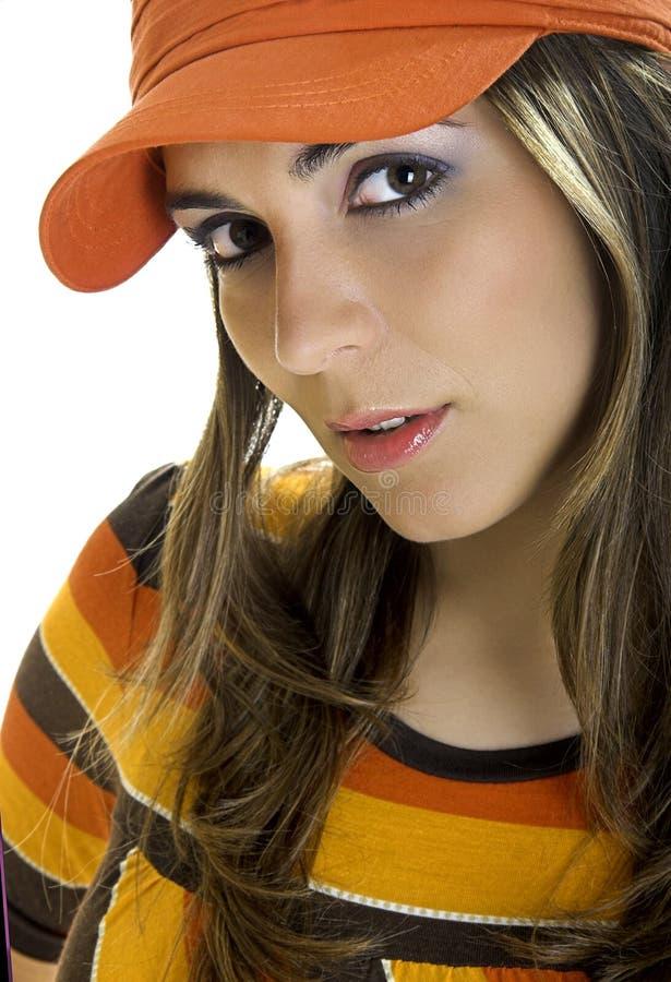 Vrouw met een oranje hoed royalty-vrije stock afbeelding