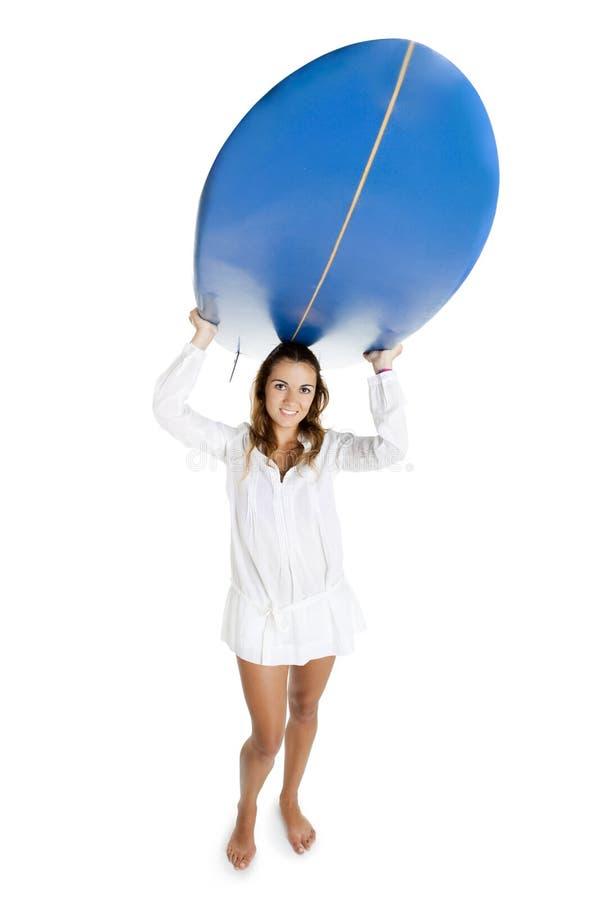 Vrouw met een surfplank royalty-vrije stock afbeelding