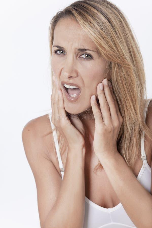 Vrouw met een tandpijn royalty-vrije stock fotografie