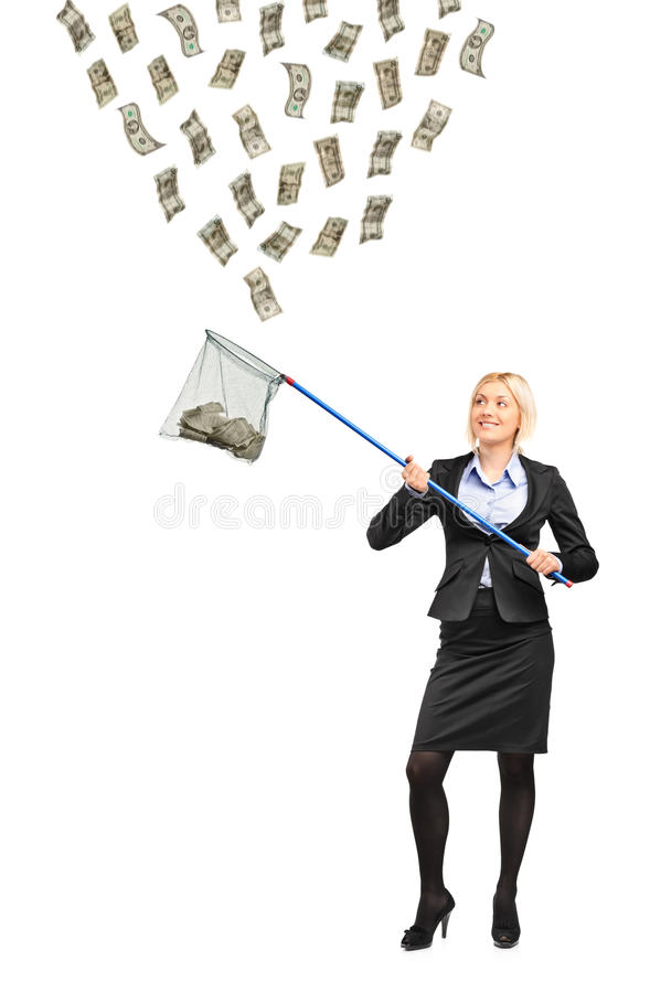 Vrouw met een visserijnet dat geld probeert te vangen royalty-vrije stock fotografie
