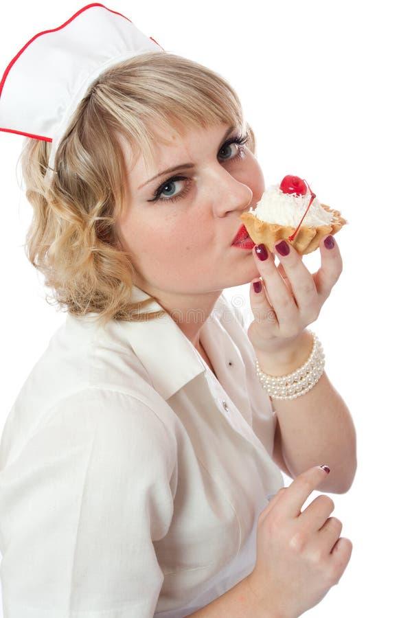 Vrouw met gebakje stock afbeelding