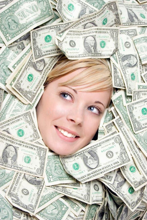 Vrouw met geld stock foto