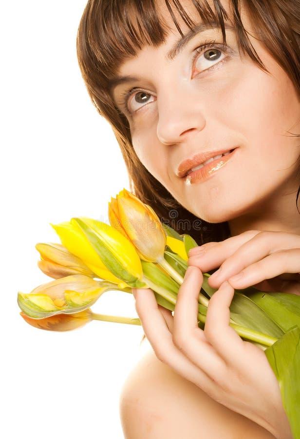 Vrouw met gele tulpen royalty-vrije stock foto's