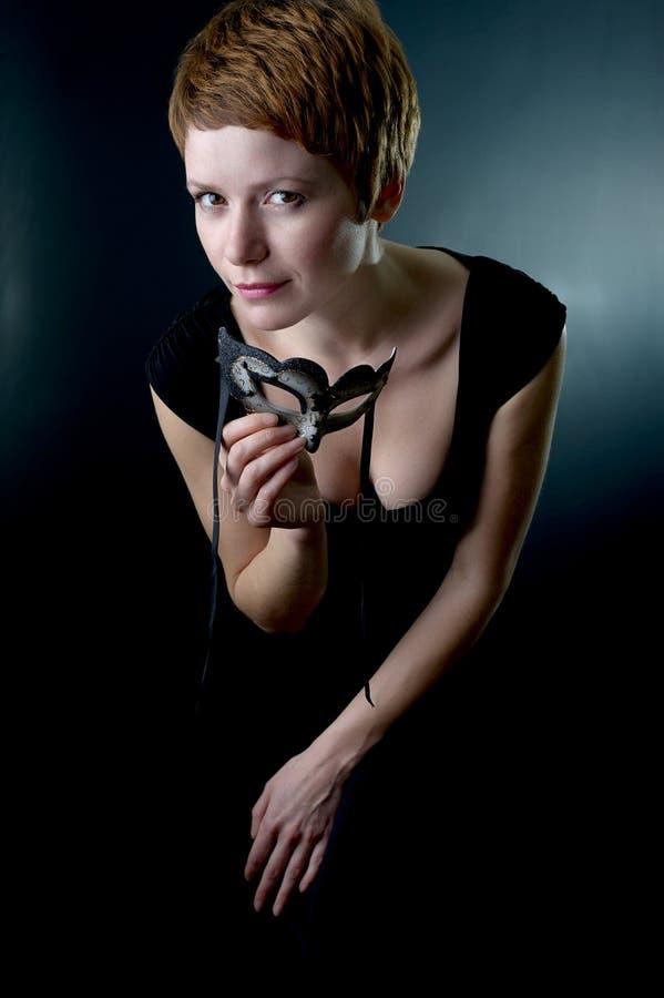 Vrouw met gezichtsmasker. royalty-vrije stock afbeelding