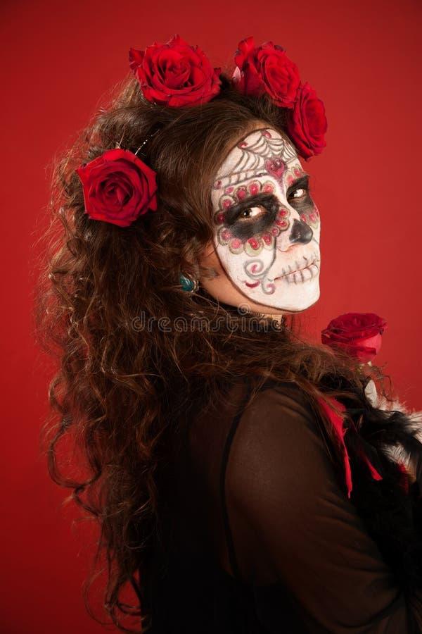 Vrouw met gezichtsverf in Dag van de Dode stijl royalty-vrije stock afbeeldingen