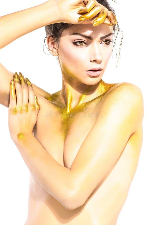 Vrouw met gouden lichaamsart. royalty-vrije stock fotografie