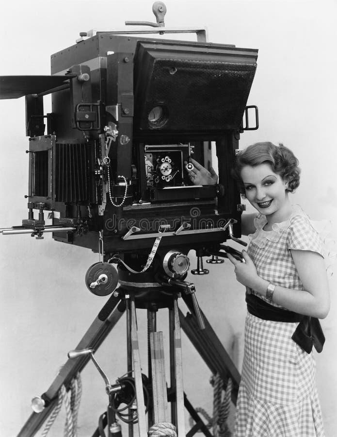 Vrouw met grote camera stock foto's