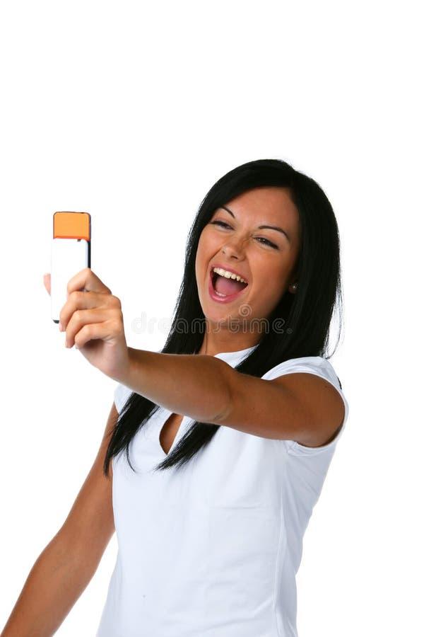 Vrouw met haar celtelefoon stock afbeelding