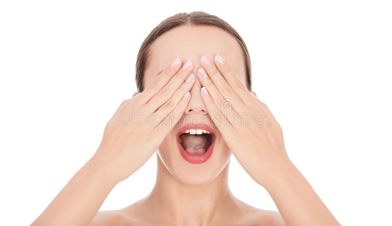 Vrouw met haar handen op wijd open gezicht en haar mond stock foto's