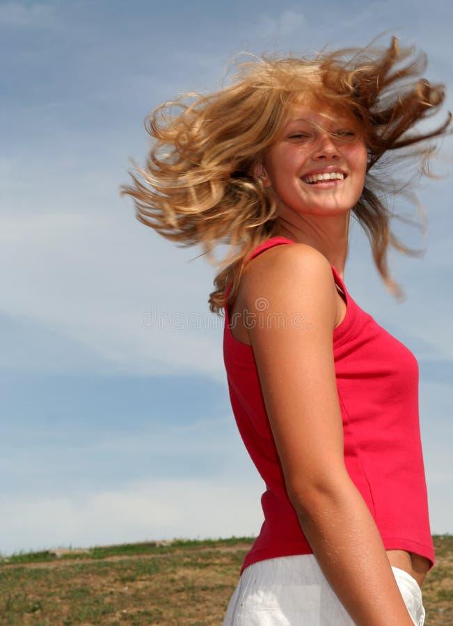 Vrouw met haar het vliegen stock foto