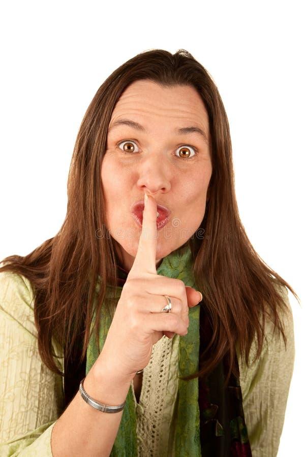 Vrouw met haar vinger aan lippen royalty-vrije stock afbeeldingen