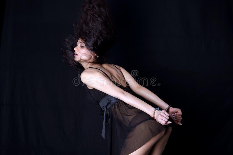 Vrouw met handcuff stock afbeeldingen