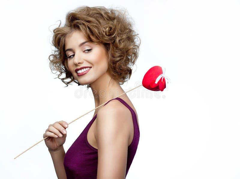 Vrouw met hart stock foto's