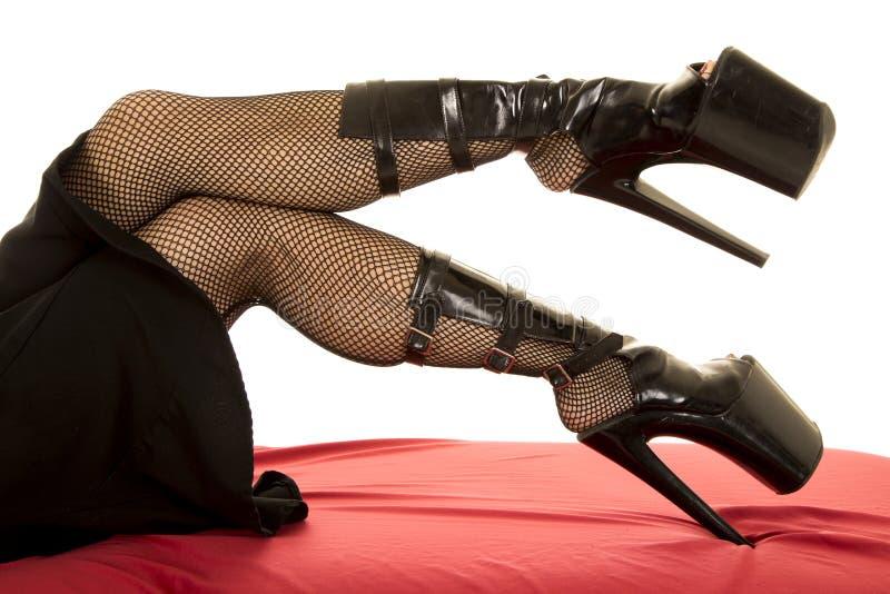 Vrouw met het dikke uit visnet van hielenbenen stock fotografie
