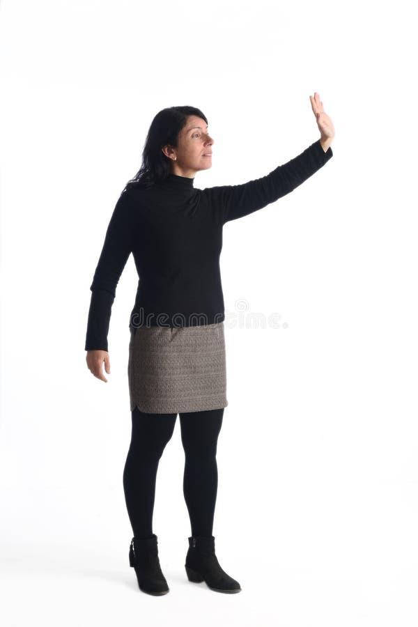 Vrouw met het opgeheven wapen stock afbeelding