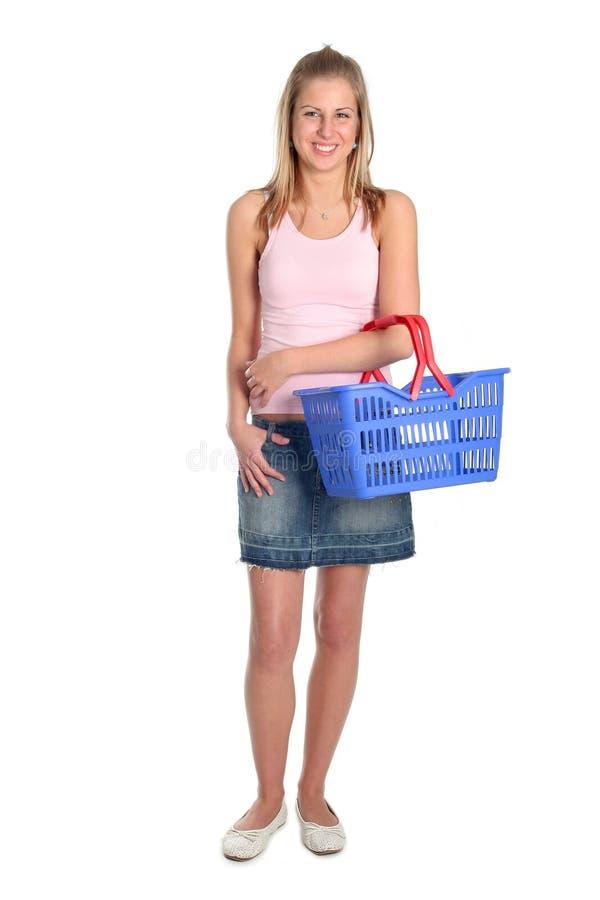 Vrouw met het winkelen mand stock afbeelding