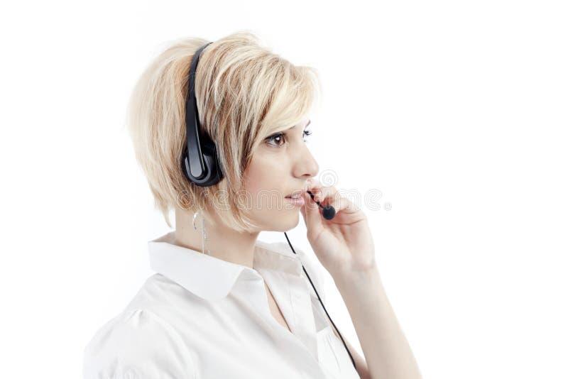 Vrouw met hoofdtelefoon stock foto
