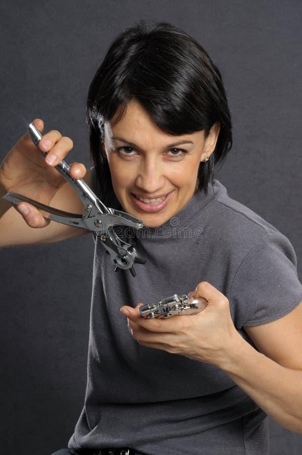 Vrouw met hulpmiddelen royalty-vrije stock afbeelding