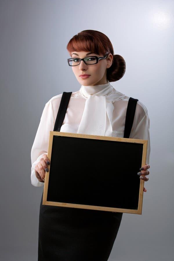 Vrouw met klein bord royalty-vrije stock foto