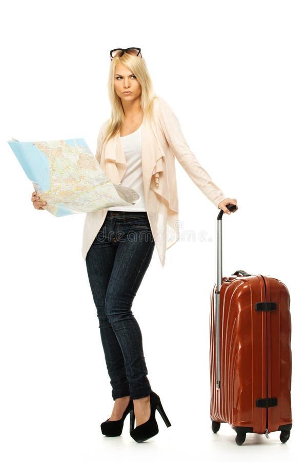 Vrouw met koffer en kaart royalty-vrije stock foto