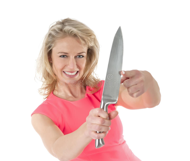 Vrouw met lang keukenmes stock foto's