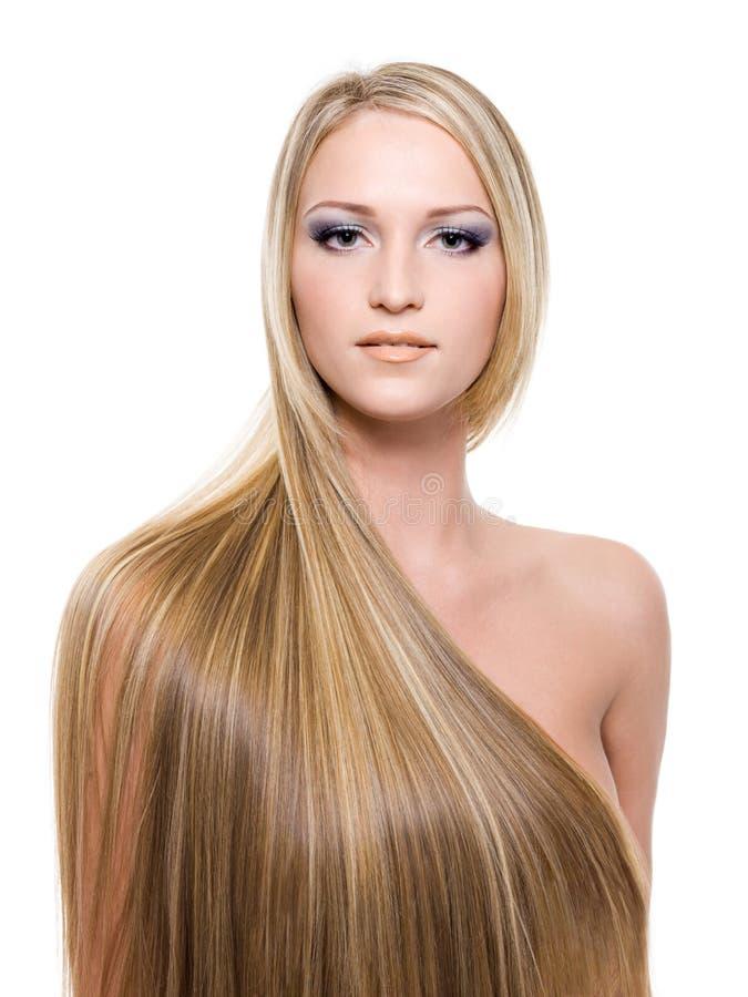 Vrouw met lang recht blond haar stock fotografie