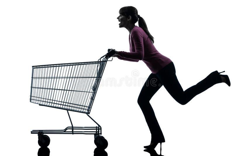 Vrouw met leeg boodschappenwagentjesilhouet stock foto