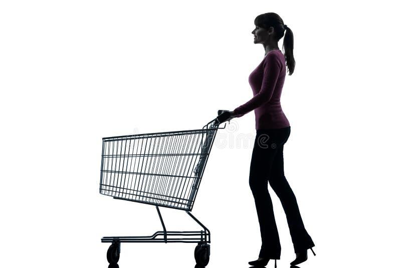 Vrouw met leeg boodschappenwagentjesilhouet royalty-vrije stock fotografie
