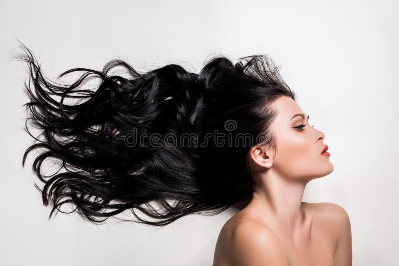 Vrouw met mooi zwart haar stock fotografie