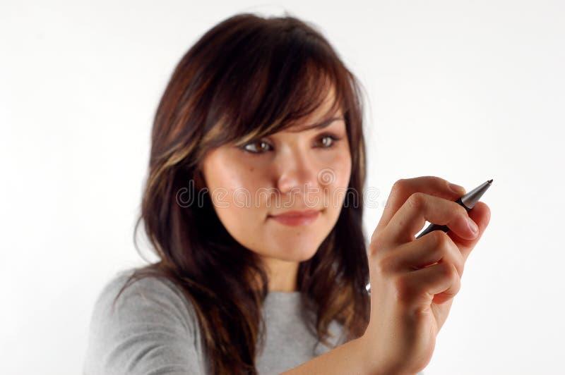 Vrouw met pen stock foto