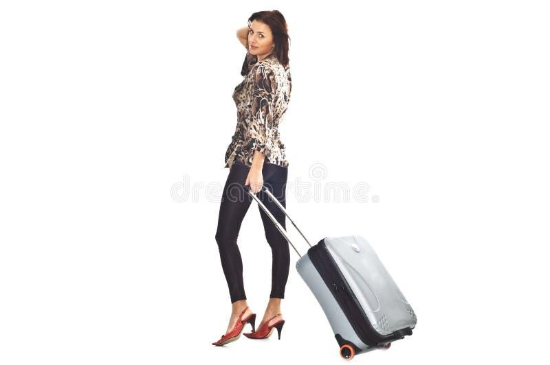 Vrouw met reiszak stock foto's
