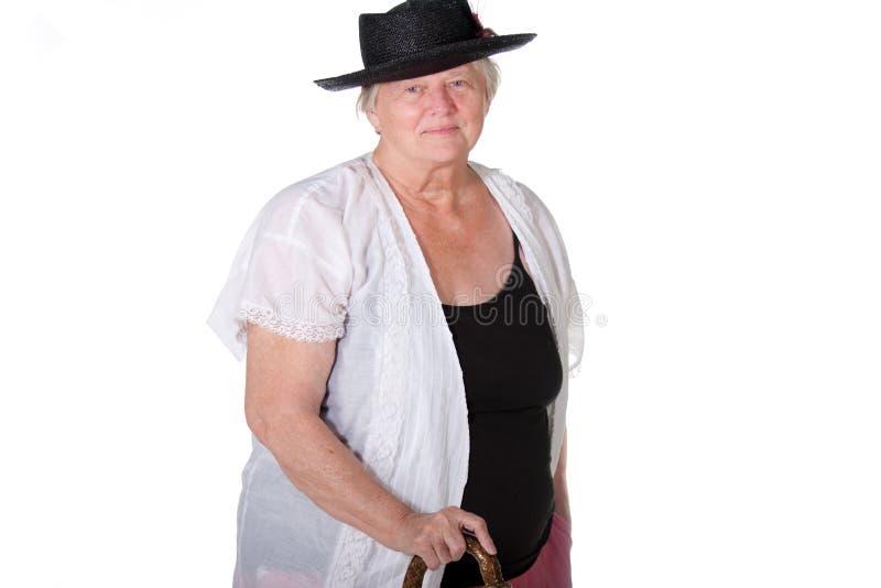 Vrouw met riet en hoed stock foto's