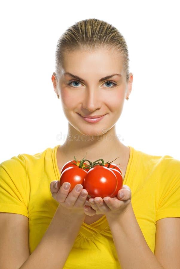 Vrouw met rijpe tomaten stock foto's