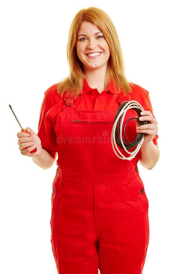 Vrouw met rode algemeen als elektricien stock fotografie