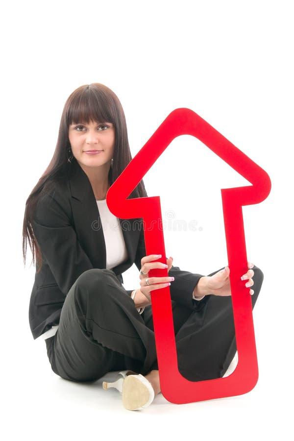 Vrouw met rode stijgende pijl stock afbeelding