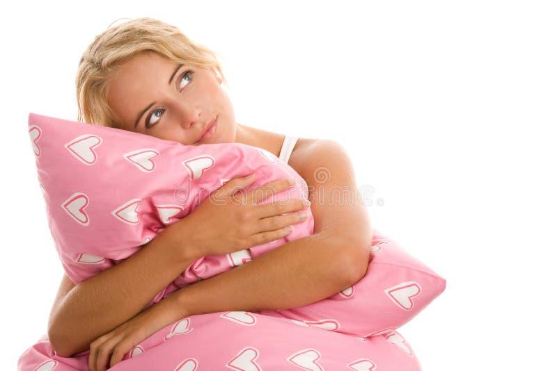 Vrouw met roze hoofdkussen royalty-vrije stock foto