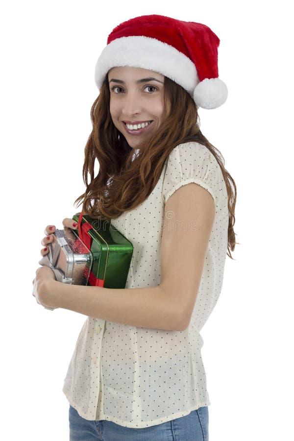 Vrouw met Santa Claus-hoedenholding op haar giften stock foto's