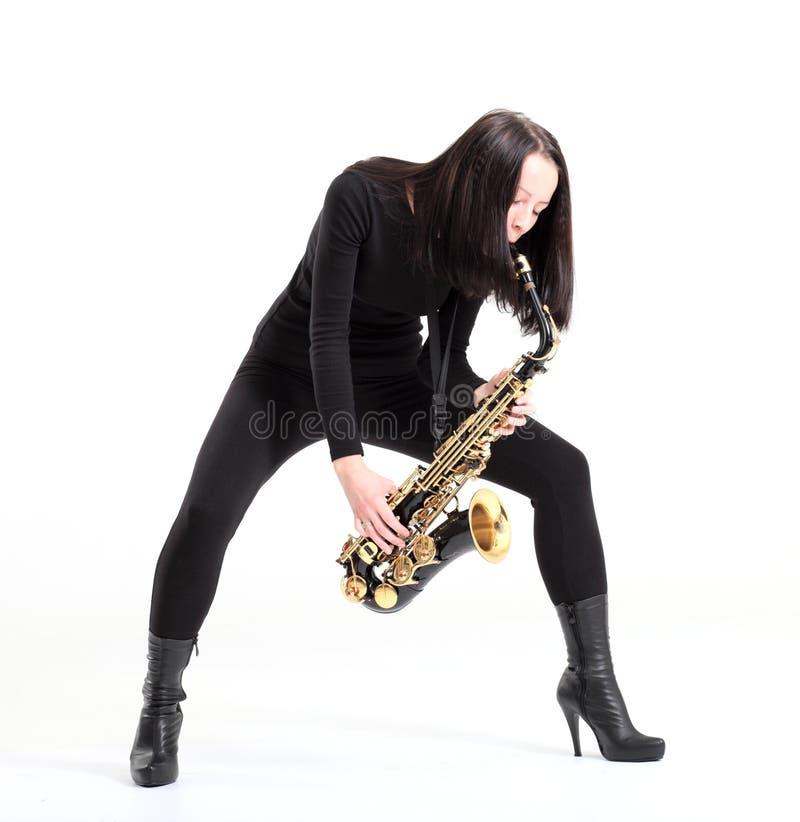 Vrouw met saxofoon. stock foto's