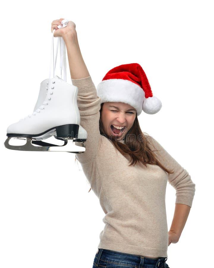 Vrouw met schaatsen die klaar voor ijs het schaatsen de wintersport worden royalty-vrije stock afbeelding