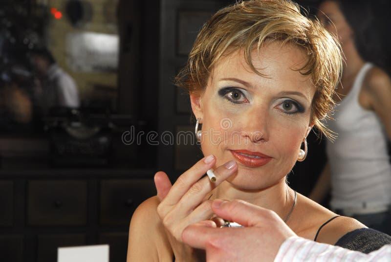 Vrouw met sigaret 3 stock afbeeldingen