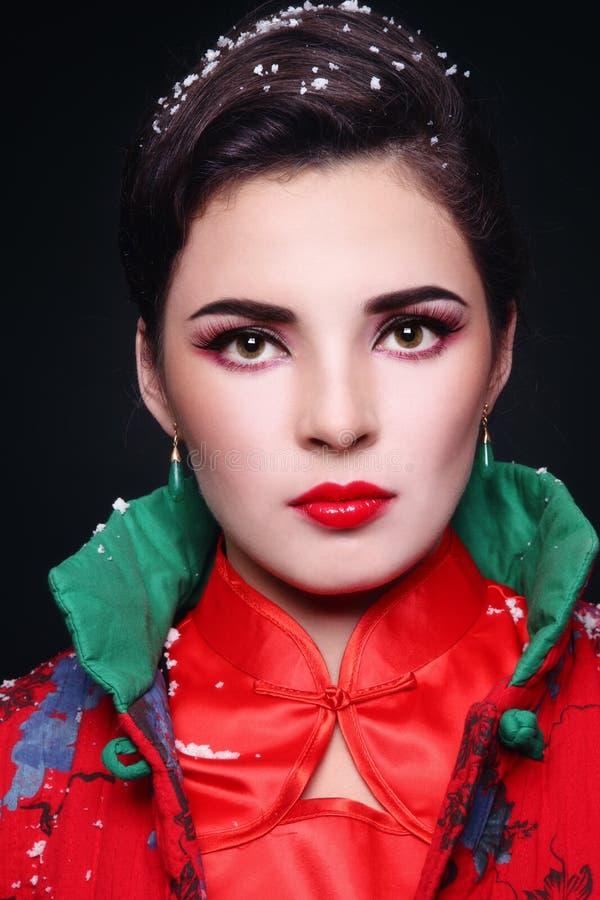 Vrouw met sneeuwvlokken royalty-vrije stock afbeeldingen
