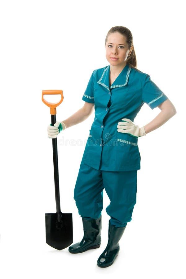 Vrouw met spade stock afbeelding