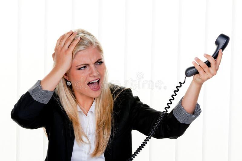 Vrouw met spanning in het bureau stock afbeeldingen
