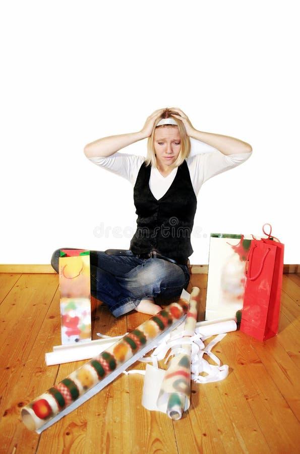 vrouw met spanning op Kerstmis stock afbeelding