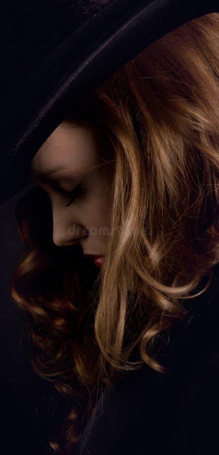 Vrouw met stovepipe stock fotografie