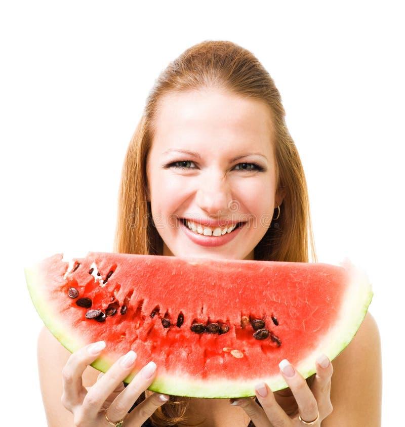 Vrouw met stuk van watermeloen royalty-vrije stock afbeeldingen